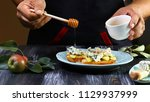 cooking bruschetta with pears ... | Shutterstock . vector #1129937999