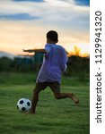 kids are playing soccer... | Shutterstock . vector #1129941320