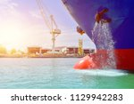 bulbous bow ship during drain... | Shutterstock . vector #1129942283