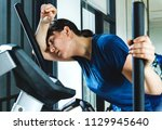 Small photo of Woman tired after a hard workout