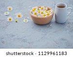 chamomile tea with fresh... | Shutterstock . vector #1129961183