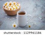 chamomile tea with fresh... | Shutterstock . vector #1129961186
