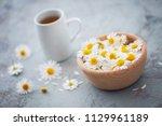 chamomile tea with fresh... | Shutterstock . vector #1129961189