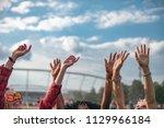 friends dancing with hands in... | Shutterstock . vector #1129966184
