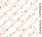 gold heart seamless pattern.... | Shutterstock .eps vector #1129984676