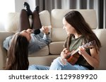 two sisters alone in the house... | Shutterstock . vector #1129989920
