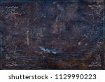 ancient damaged leather cover... | Shutterstock . vector #1129990223