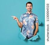 handsome man with flower shirt... | Shutterstock . vector #1130004533