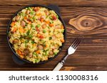 risotto with peas   carrots  ... | Shutterstock . vector #1130008316