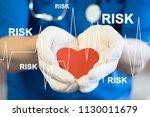 doctor pushing button risk... | Shutterstock . vector #1130011679