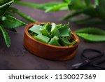 aloe vera on dark background  ... | Shutterstock . vector #1130027369