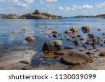 numerous stony islands and bays ... | Shutterstock . vector #1130039099