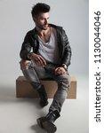 handsome man wearing black... | Shutterstock . vector #1130044046