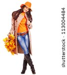 Woman wearing overcoat holding  orange leaves. - stock photo
