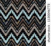 seamless ethnic zigzag chevron... | Shutterstock .eps vector #1130046773
