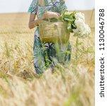 beautiful slim model in a dress ... | Shutterstock . vector #1130046788