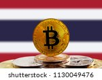 bitcoin btc on stack of... | Shutterstock . vector #1130049476