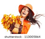 Woman holding  orange leaf and handbag. Autumn fashion. - stock photo
