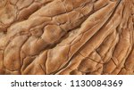 walnut shell extreme macro as... | Shutterstock . vector #1130084369