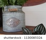 vintage style tin pot on brown...   Shutterstock . vector #1130085326