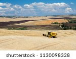 combine harvester on wheat... | Shutterstock . vector #1130098328