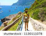 female hiker go down and...   Shutterstock . vector #1130111078