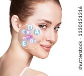 woman face with vitamins icons. ... | Shutterstock . vector #1130131316