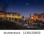 an evening in ivrea ponte... | Shutterstock . vector #1130133833
