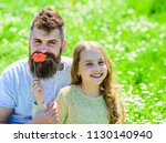 family spend leisure outdoors.... | Shutterstock . vector #1130140940