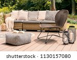 patterned pouf and rattan chair ... | Shutterstock . vector #1130157080