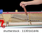 piano tuner is tuning upright... | Shutterstock . vector #1130161646