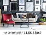 red armchair near beige sofa in ... | Shutterstock . vector #1130163869