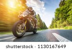 motorbike on the forest road... | Shutterstock . vector #1130167649