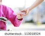 senior lady in wheelchair... | Shutterstock . vector #113018524