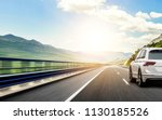 Stock photo white car rushing along a high speed highway toned photo 1130185526