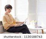 young woman working with laptop ... | Shutterstock . vector #1130188763