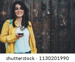 cheerful young woman using... | Shutterstock . vector #1130201990