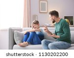 father arguing with son at home | Shutterstock . vector #1130202200
