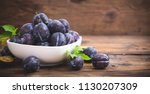 fresh organic plums in the bowl | Shutterstock . vector #1130207309