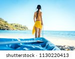 woman dragging her boat to the... | Shutterstock . vector #1130220413