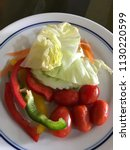 vegetables on a plate | Shutterstock . vector #1130220599