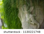 cupid statue in garden | Shutterstock . vector #1130221748