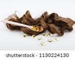 oil capsule for hair with... | Shutterstock . vector #1130224130