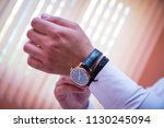 a businessman touches and... | Shutterstock . vector #1130245094