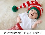 Adorable Baby In Christmas Hat...