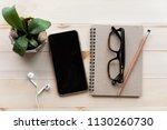 office desk with notebooks... | Shutterstock . vector #1130260730
