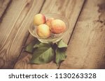 organic apricots on rustic... | Shutterstock . vector #1130263328