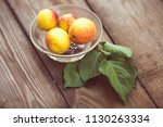 organic apricots on rustic... | Shutterstock . vector #1130263334