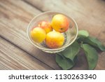 organic apricots on rustic... | Shutterstock . vector #1130263340