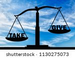 on the scales of justice  two... | Shutterstock . vector #1130275073